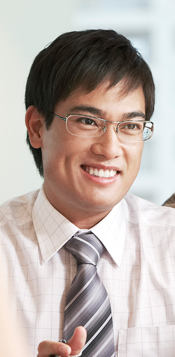 Image of smiling man wearing glasses